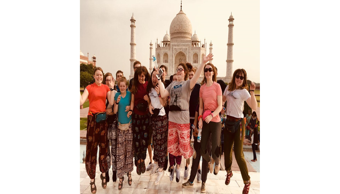 jumping in front of Taj